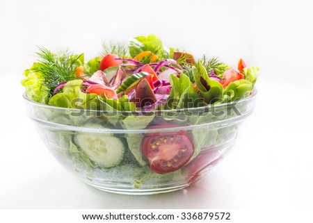 Bowl of Healthy Vegetable Salad on White Background