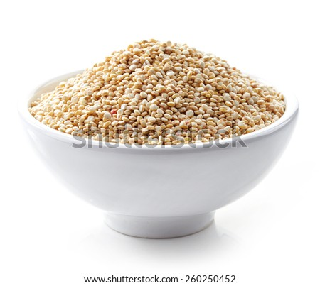 bowl of healthy white quinoa seeds isolated on white - stock photo