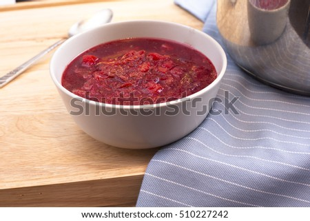 Bowl of homemade borscht on table.