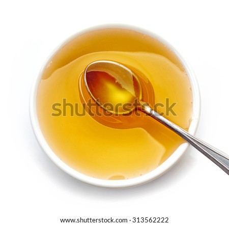 bowl of honey isolated on white background, top view - stock photo