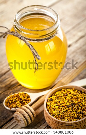 Bowl of honey on wooden table. Symbol of healthy living and natural medicine. Aromatic and tasty. food - stock photo