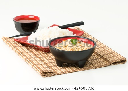 Bowl of Japanese ramen noodles and a cup of green tea. - stock photo