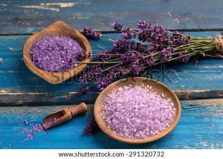 bowl of lavender bath salt and lavender flower - beauty treatment - stock photo