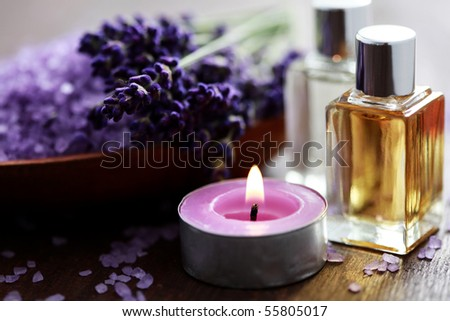 bowl of lavender bath salt and massage oil - beauty treatment - stock photo