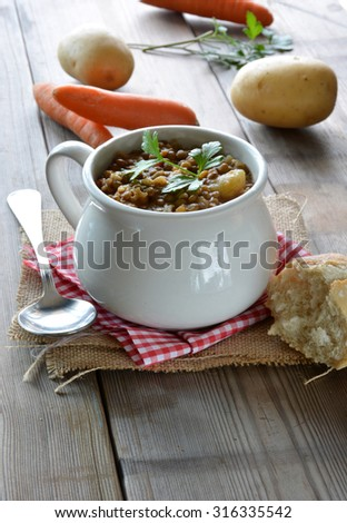 bowl of lentil stew with potatoes and carrots