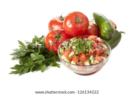 Bowl of Mexican salsa, jalapeno, tomatoes and parsley - stock photo