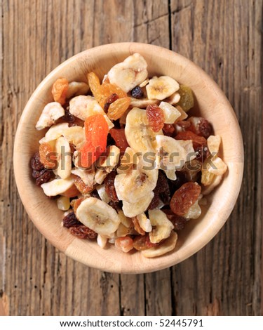 Bowl of mixed dried fruit - stock photo