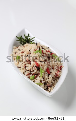 Bowl of mixed rice with chopped vegetables   - stock photo
