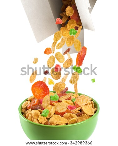 Bowl of muesli and dried fruit isolated on a white background. Box of muesli.