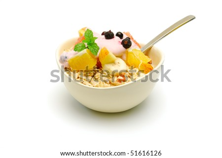 bowl of muesli with fruit salad isolated