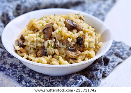 Bowl of mushroom risotto garnished with thyme - stock photo