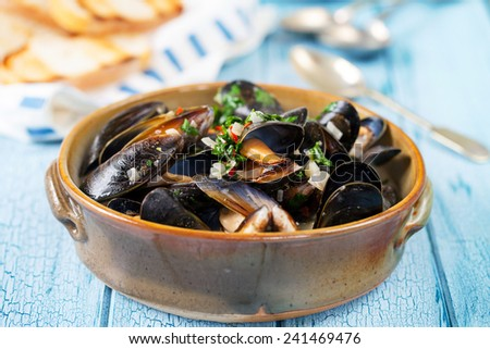 Bowl of mussels - stock photo