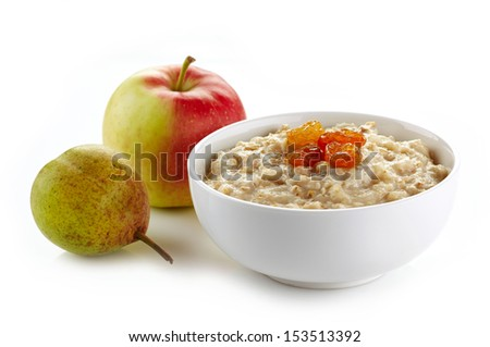 Bowl of oats porridge with raisins and fresh fruits. Healthy breakfast - stock photo