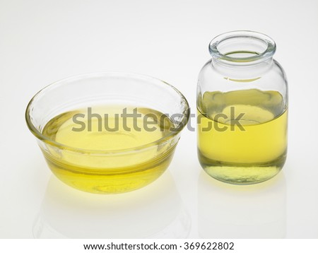 bowl of oil on the white background - stock photo