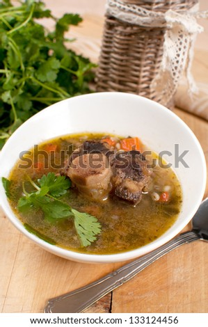 Bowl of ox tail meat soup with barley vertical - stock photo