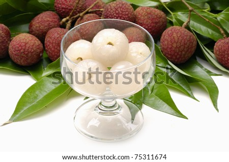 Bowl of peeled lychee with leaf - stock photo