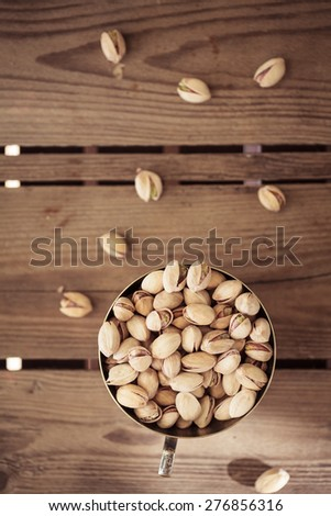 bowl of pistachio nuts - stock photo