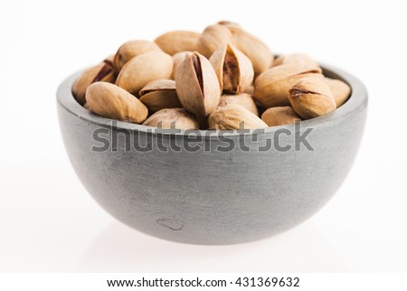 bowl of pistachios on white background - stock photo