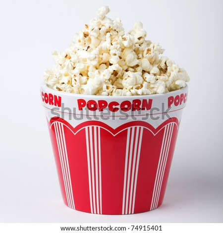 Bowl of popcorn on a white (gray) background - stock photo