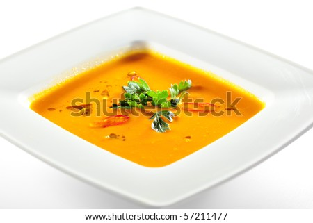 Bowl of Pumpkin Soup with Green Parsley - stock photo