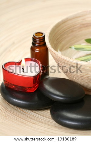 bowl of pure water and candle - beauty treatment