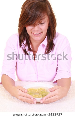 bowl of pure water with citrus fruits - hands care - stock photo