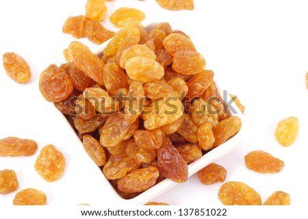 Bowl of raisins - stock photo