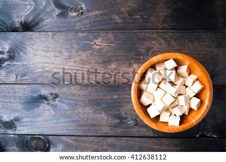 Bowl of raw tofu cubes. Copy space. Menu page - stock photo