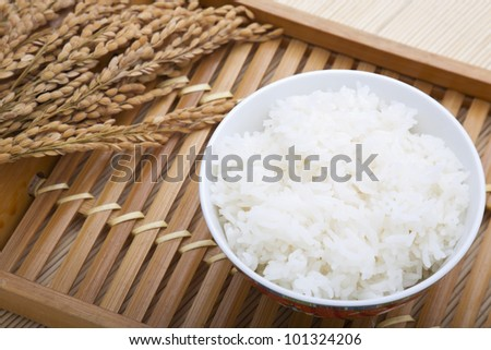 Bowl of rice and paddy - stock photo