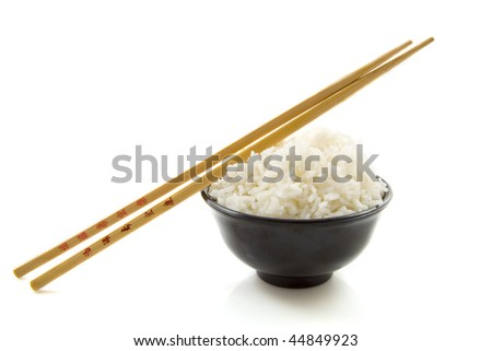Bowl of rice with chopsticks isolated over white - stock photo