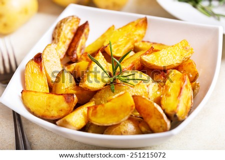 bowl of roasted potatoes with rosemary - stock photo