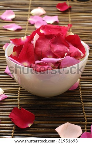 Bowl of rose petals-spa background - stock photo