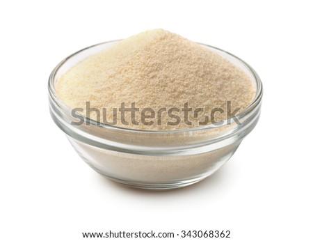 Bowl of semolina isolated on white - stock photo