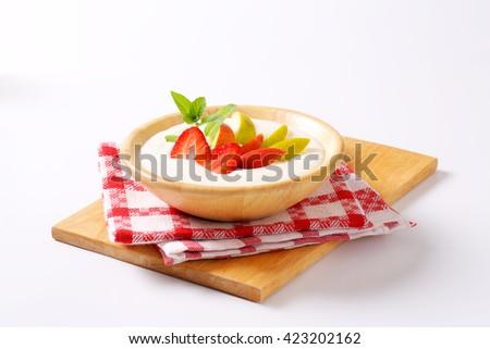 Bowl of semolina pudding with fresh fruits - stock photo