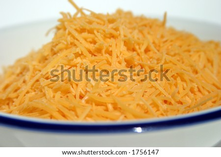 bowl of shredded chedder cheese - stock photo