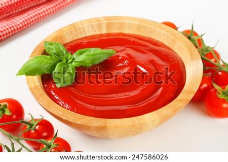 Bowl of smooth tomato passata - stock photo