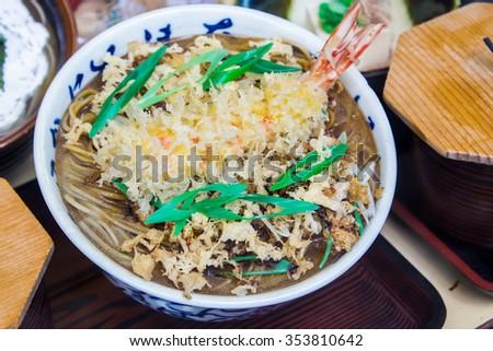 bowl of Soba ( Japanese buckwheat noodles ) with prawn tempura - stock photo