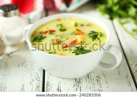 Bowl of soup on white wooden background  - stock photo