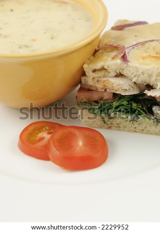 bowl of soup with chicken sandwich