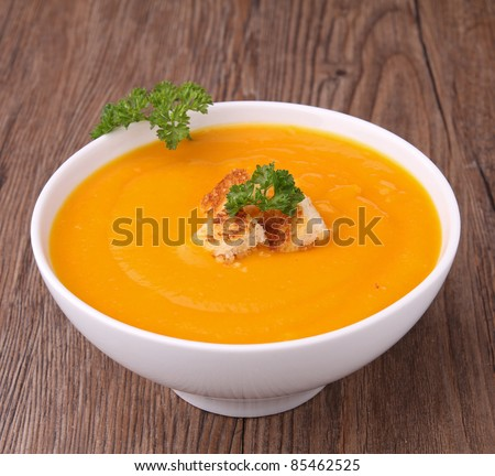 bowl of soup with croutons and parsley - stock photo