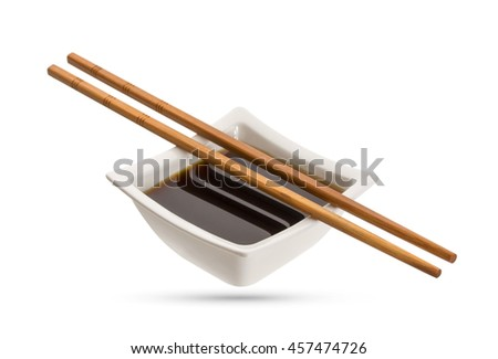 Bowl of soy sauce and chopsticks isolated on white background - stock photo