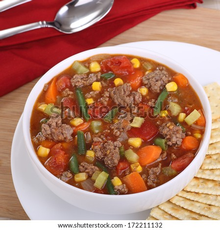 Bowl of vegetable soup with hamburger meat - stock photo