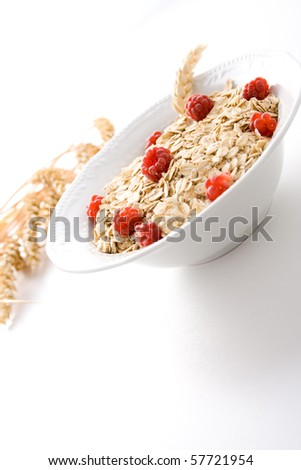 Bowl of wheat cereal with fresh raspberries.