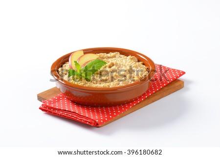 Bowl of white oats porridge - stock photo