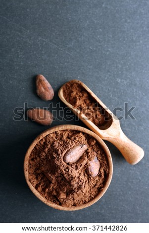 Bowl with aromatic cocoa powder on grey background, close up - stock photo