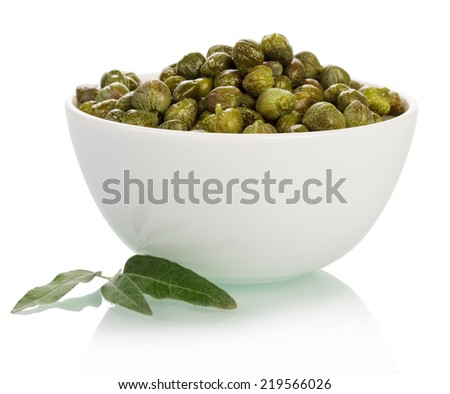 Bowl with capers isolated on white background - stock photo