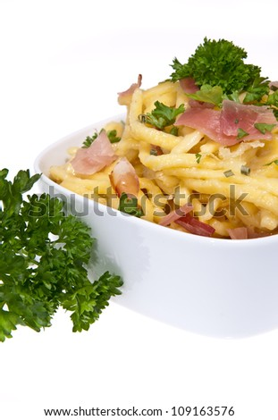 Bowl with Cheese Spaetzle and Parsley isolated on white background