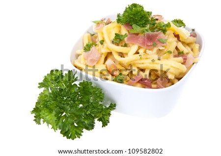 Bowl with Cheese Spaetzle and Parsley isolated on white background - stock photo