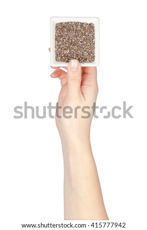 bowl with chia seeds in a hand isolated on white background. superfoods