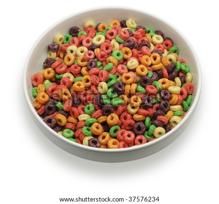 Bowl with colorful round cereal, seen from almost straight above, isolated on white background. Saved with clipping path